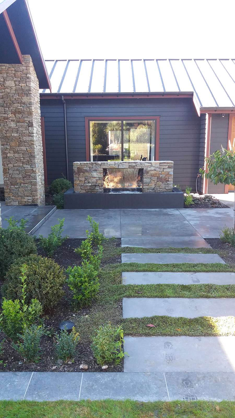 Polished Concrete with Gardens and water feature landscaping